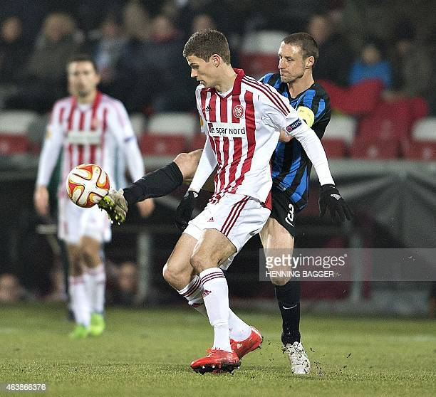 Aalborg's Nicklas Helenius and Club Brugge's Timmy Simons vie for the ball during Aalborg BK v Club Brugge KV during UEFA Europa League Round of 32...