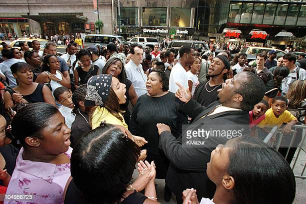 Aaliyah fans singing Aaliyah songs outside Cipriani Restaurant in Midtown Manhattan where a public memorial is being held