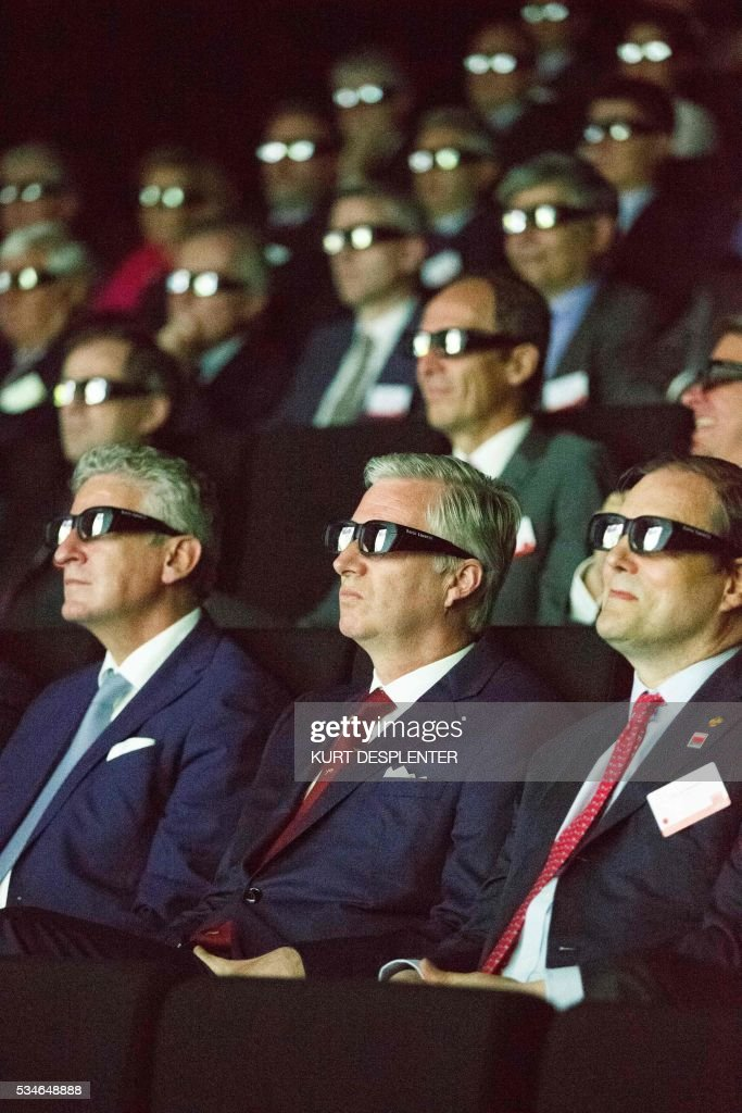 Aalter mayor Pieter De Crem, King Philippe of Belgium and Barco chairman Charles Beauduin wear glasses during a visit to the hardware and software manufacturer Barco group, May 27, 2016, in Kortrijk. / AFP / Belga / KURT DESPLENTER / Belgium OUT