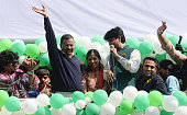 Aam Aadmi Party chief and its chief ministerial candidate for Delhi Arvind Kejriwal waving to his supporters in New Delhi