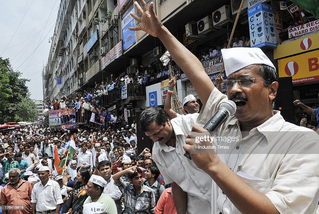 Aam Aadmi Party leader Arvind Kejriwal addressing a gathering of traders at Nehru Place market during campaigning for the upcoming Delhi Vidhan Sabha...