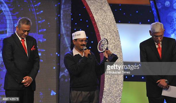 Aam Aadmi Party leader Arvind Kejriwal receives politician of The Year award from former Auditor General of India Vinod Rai on December 20 2013 in...