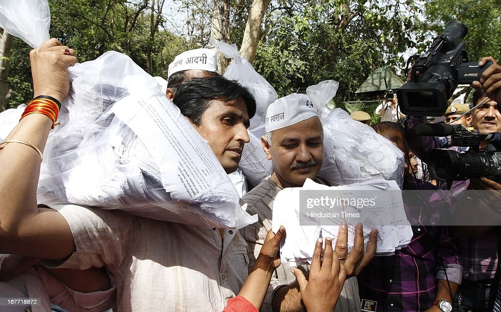 Aam Aadmi Party leaders Manish Sisodiya ( R) and Kumar Biswas arrives at the residence of Delhi Chief minister, Sheila Dikshit with the 10.5 lakh letters from consumers stating that they would not pay inflated bills on April 28, 2013 in New Delhi, India. The Arvind Kejriwal-led party decided to call off their march to residence of Delhi Chief Minister Sheila Dikshit after her office accepted to receive the 10.5 lakh letters written against inflated power and water bills.