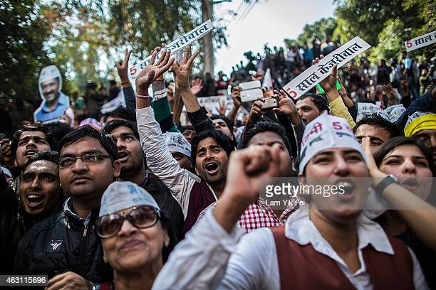 Aam Aadmi Party supporters shout as they watch the results of Delhi Assembly Elections outside the party office at Patel Nagar on February 10 2015 in...