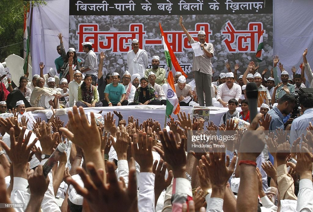 Aam Admi Party leader Arvind Kejriwal, addresses supporters during a protest against the Delhi government demanding reduction in water and power tariffs at Jantar Mantar on April 28, 2013 in New Delhi, India. The Arvind Kejriwal-led party decided to call off their march to residence of Delhi Chief Minister Sheila Dikshit after her office accepted to receive the 10.5 lakh letters written against inflated power and water bills.