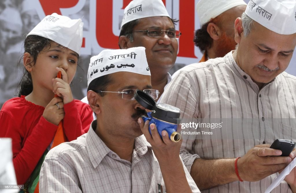 Aam Admi Party leader Arvind Kejriwal, shows water meter working by blowing air into it during a protest against the Delhi government demanding reduction in water and power tariffs at Jantar Mantar on April 28, 2013 in New Delhi, India. The Arvind Kejriwal-led party decided to call off their march to residence of Delhi Chief Minister Sheila Dikshit after her office accepted to receive the 10.5 lakh letters written against inflated power and water bills.