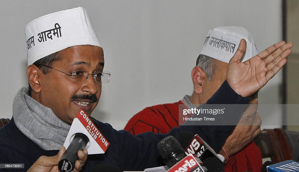 Aam Admi Party leaders Arvind Kejriwal address the media on electricity prices on February 1, 2013 in New Delhi, India. Targetting the Delhi Chief Minister Sheila Dikshit, The AAM Party leader alleged that power distribution companies in the capital fudged their records and committed fraud to show losses in their revenue while actually making profits.