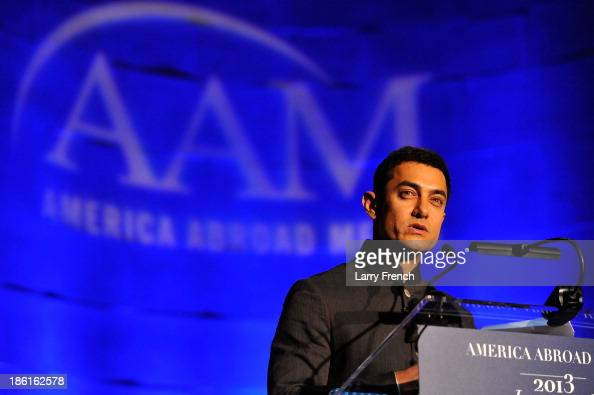 Aamir Kahn speaks at the 2013 America Abroad Media Awards Dinner at Andrew W Mellon Auditorium on October 28 2013 in Washington DC