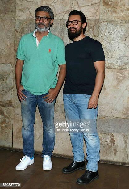 Aamir Khan and Nitesh Tiwari during the special screening of film Dangal in Mumbai
