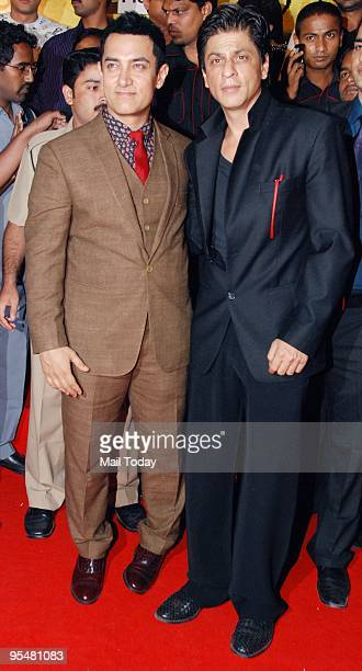 Aamir Khan and Shah Rukh Khan at the premiere of the film 3 Idiots in Mumbai on Wednesday December 23 2009