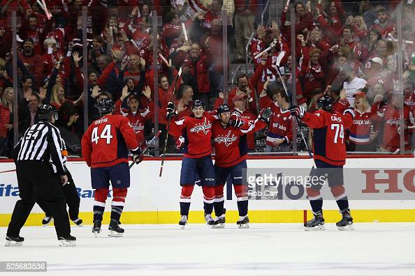Andre Burakovsky of the Washington Capitals celebrates with teammate Jason Chimera after scoring a first period gaol against the Pittsburgh Penguins...
