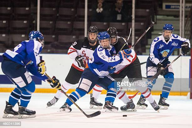 Aapeli Rasanen of Finland battles for the puck against Brett Howden of Canada White during the World Under17 Hockey Challenge on November 2 2014 at...