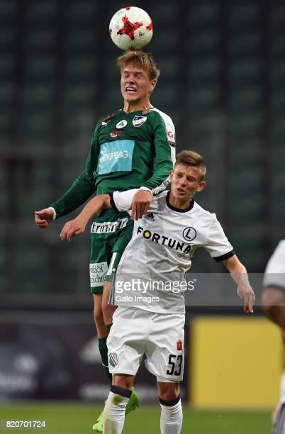 Aapo Maenpaa of IFK Mariehamn headers the ball Sebastian Szymanski of Legia Warszawa during the match between Legia Warszawa and IFK Mariehamn in the...