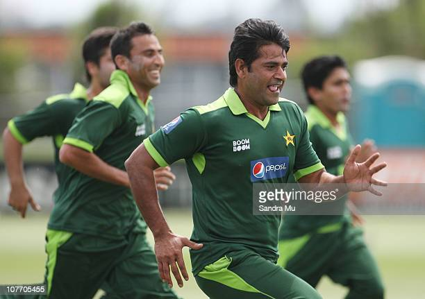 Aaqib Javed Assistant Coach of Pakistan warms up with the team during a Pakistan training session at Colin Maiden Park on December 21 2010 in...