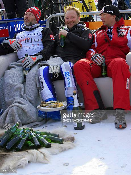 Norwegians Lasse Kjus and Kjetil Andre Aamodt drink Champagne and beer with Austrian Fritz Strobl to celebrate Kjus retirement from ski competition...