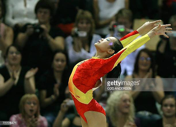 Gymnast Cheng Fei of China finishes her performance on the vault during the women's apparatus final at the Arena in Aarhus 20 October 2006 at the...