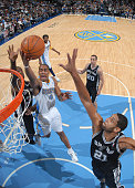 Aaron Afflalo of the Denver Nuggets goes to the basket against Tim Duncan of the San Antonio Spurs on December 16 2010 at the Pepsi Center in Denver...