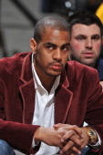 Aaron Afflalo of the Denver Nuggets watches the game from the bench against the Washington Wizards on March 25 2011 at the Pepsi Center in Denver...