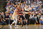 Aaron Afflalo of the Portland Trail Blazers posts up against Stephen Curry of the Golden State Warriors on April 9 2015 at Oracle Arena in Oakland...