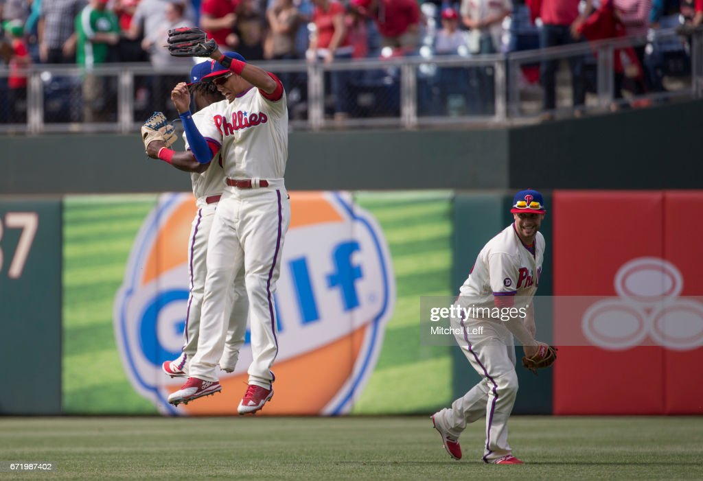 Aaron Altherr #23, Odubel Herrera #37, and Daniel Nava #25 of the Philadelphia Phillies celebrate after the game against the Atlanta Braves at Citizens Bank Park on April 23, 2017 in Philadelphia, Pennsylvania. The Phillies defeated the Braves 5-2.