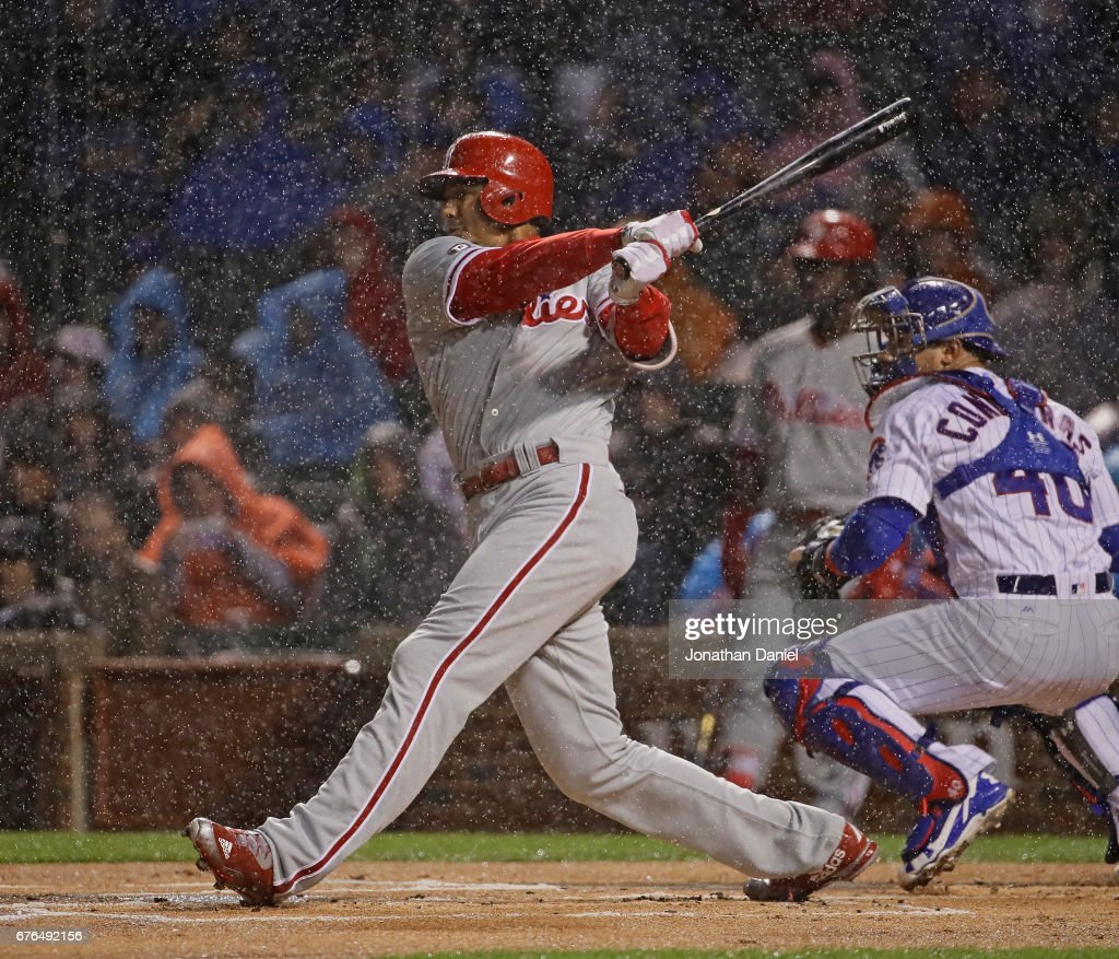 Aaron Altherr #23 of the Philadelphia Phillies hits a run scoring double in the first inning against the Chicago Cubs at Wrigley Field on May1, 2017 in Chicago, Illinois.