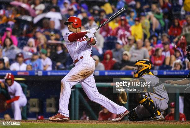 Aaron Altherr of the Philadelphia Phillies hits a tworun double in the seventh inning during a game against the Pittsburgh Pirates at Citizens Bank...