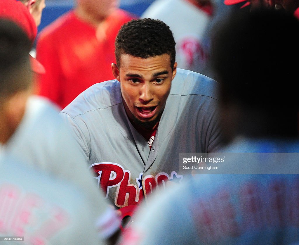 Aaron Altherr #23 of the Philadelphia Phillies is congratulated by teammates after hitting a two run home run in the fifth inning against the Atlanta Braves at Turner Field on July 28, 2016 in Atlanta, Georgia.