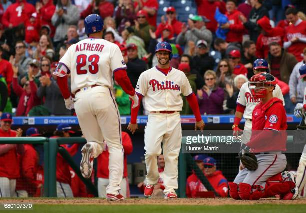 Aaron Altherr of the Philadelphia Phillies is greeted at home plate by Daniel Nava after hitting a game tying threerun home run in the eighth inning...