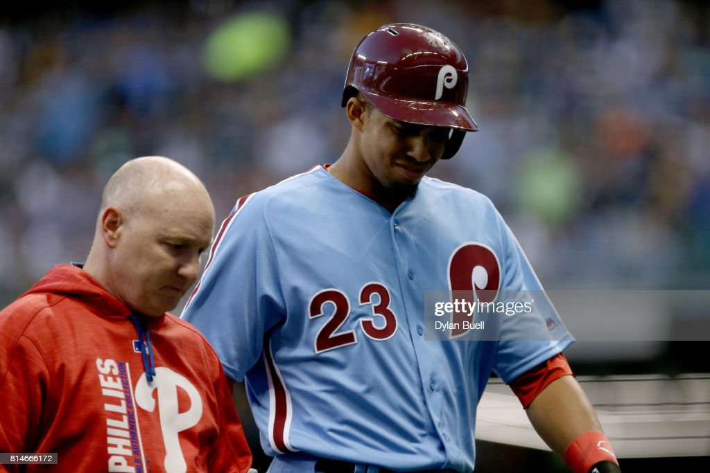 Aaron Altherr #23 of the Philadelphia Phillies leaves the game after being injured in the fifth inning against the Milwaukee Brewers at Miller Park on July 14, 2017 in Milwaukee, Wisconsin.