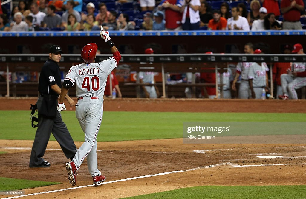 Aaron Altherr of the Philadelphia Phillies rounds the bases after hitting a solo home run in the ninth inning off of AJ Ramos of the Miami Marlins...