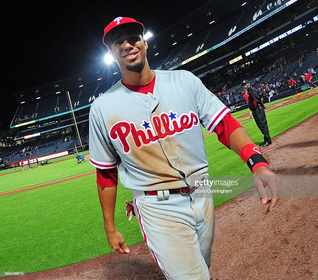 Aaron Altherr #23 of the Philadelphia Phillies smiles as he heads off the field after the game against the Atlanta Braves at Turner Field on July 28, 2016 in Atlanta, Georgia.