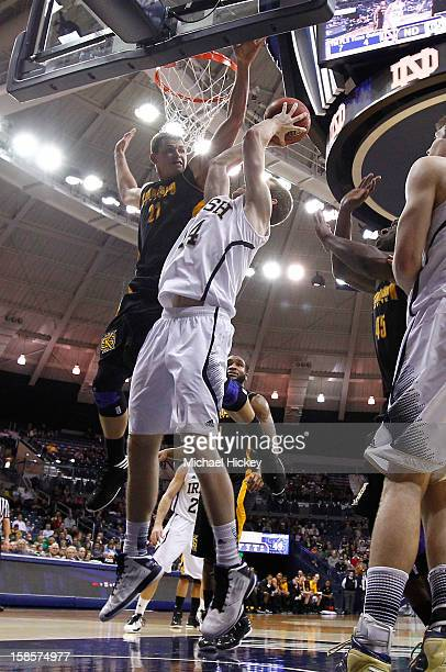 Aaron Anderson of the Kennesaw State Owls comes over the top to defend as Scott Martin of the Notre Dame Fighting Irish shoots at Purcel Pavilion on...