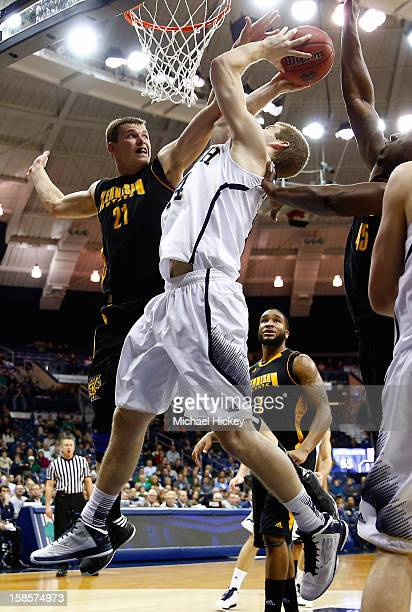 Aaron Anderson of the Kennesaw State Owls tries to block the shot of Scott Martin of the Notre Dame Fighting Irish at Purcel Pavilion on December 19...