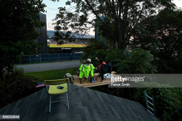 Aaron Armes and Trevor Ebner watch from a homemade scaffolding as the Pittsburgh Pirates play the St Louis Cardinals in the inaugural MLB Little...