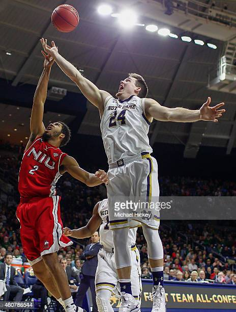 Aaron Armstead of the Northern Illinois Huskies and Pat Connaughton of the Notre Dame Fighting Irish battle for a rebound at Purcell Pavilion on...