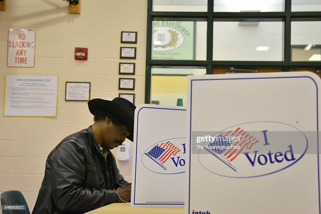 Aaron B Collier fills in his ballot sheet as Virginia voters take to the polls at Rosa Parks Elementary School on Tuesday November 2015 in Woodbridge...