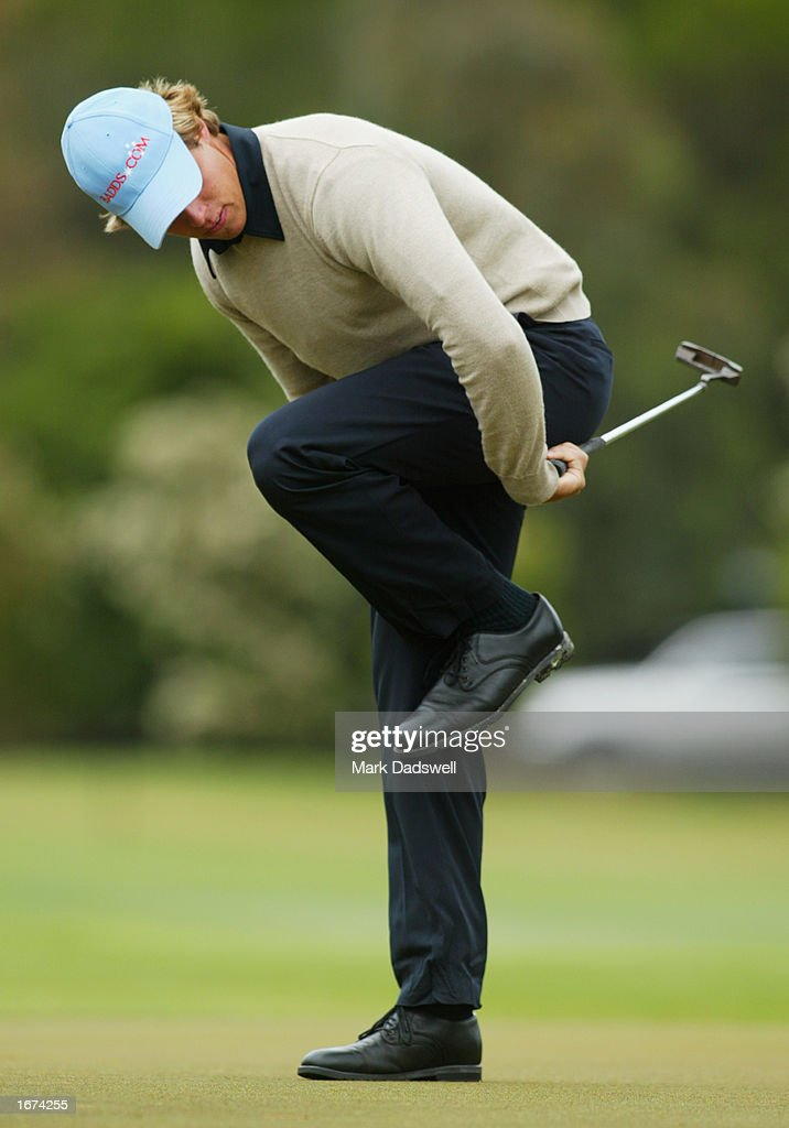 Aaron Baddeley of Australia attempts to ride his putt in, on the eighth hole during the first round of the Ericcson Masters Golf held at the Huntingdale Golf Club in Melbourne, Australia on December 5th, 2002. (Picture by Mark Dadswell/Getty Images).