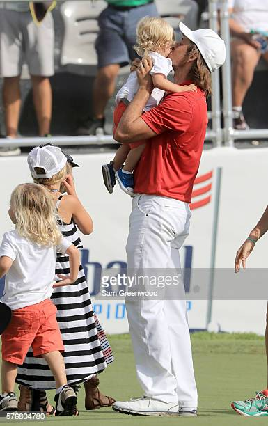 Aaron Baddeley of Australia celebrates with his family after his putt on the fourth hole of the playoff to win against Si Woo Kim of Korea during the...
