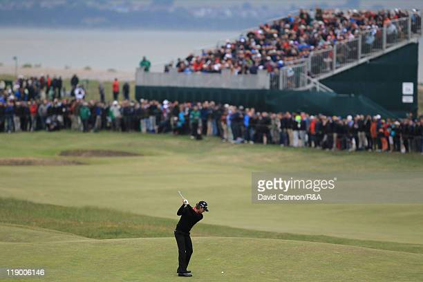 Aaron Baddeley of Australia hits his approach on the 7th hole during the first round of The 140th Open Championship at Royal St George's on July 14...
