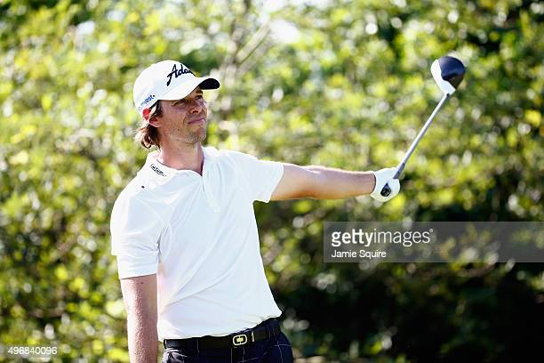 Aaron Baddeley of Australia hits his first shot on the 18th hole during the first round of the OHL Classic at the Mayakoba El Camaleon Golf Club on...