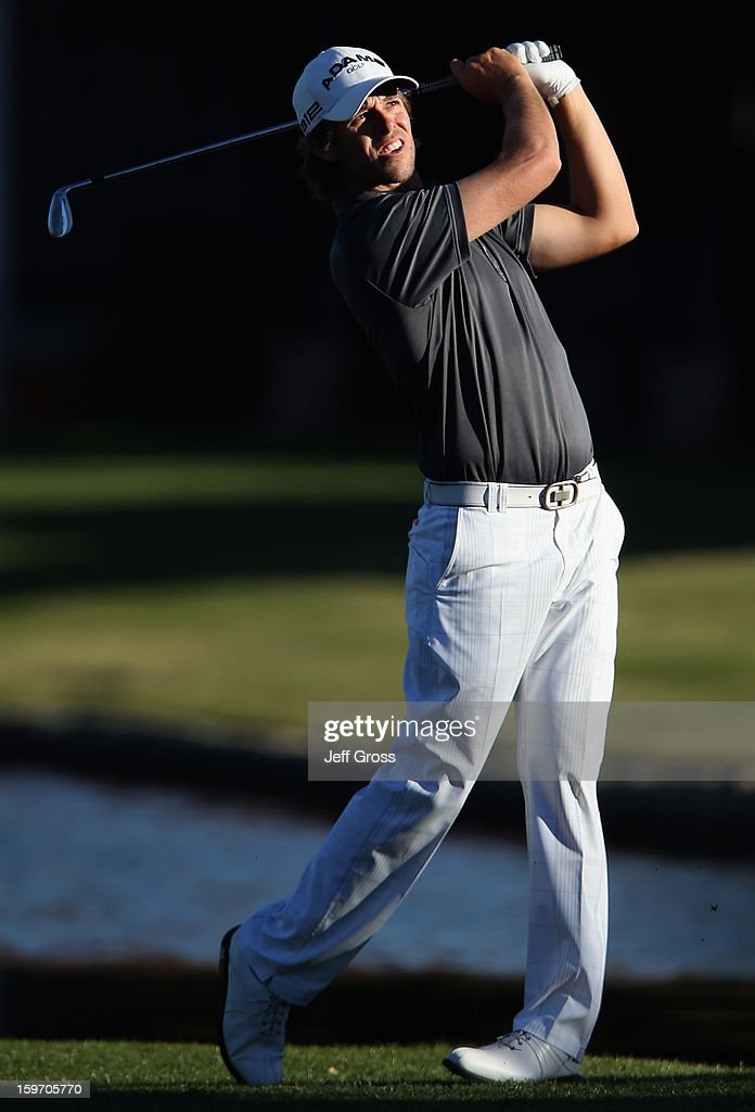 <a gi-track='captionPersonalityLinkClicked' href=/galleries/search?phrase=Aaron+Baddeley&family=editorial&specificpeople=214226 ng-click='$event.stopPropagation()'>Aaron Baddeley</a> of Australia hits his second shot on the 8th hole during the second round of the Humana Challenge In Partnership With The Clinton Foundation at La Quinta Country Club on January 18, 2013 in La Quinta, California.