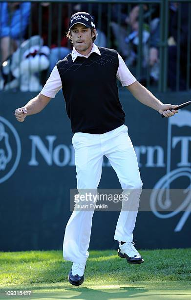 Aaron Baddeley of Australia jumps in the air as he celebrates holing his birdie putt on the 13th hole during the final round of the Northern Trust...