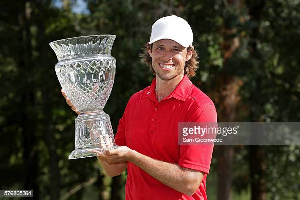 Aaron Baddeley of Australia poses with the trophy after winning during the final round of the Barbasol Championship at the Robert Trent Jones Golf...