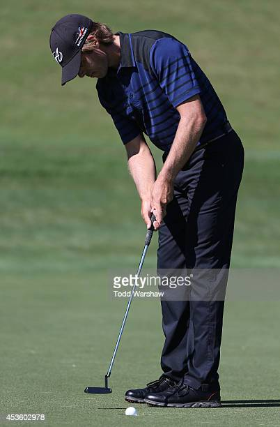 Aaron Baddeley of Australia putts on the 12th hole during the first round of the Wyndham Championship at Sedgefield Country Club on August 14 2014 in...