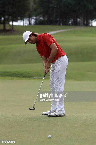 Aaron Baddeley of Australia putts on the first hole of the playoff against Si Woo Kim of Korea during the final round of the Barbasol Championship at...