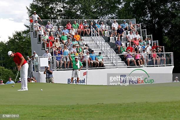Aaron Baddeley of Australia putts on the fourth hole of the playoff against Si Woo Kim of Korea during the final round of the Barbasol Championship...
