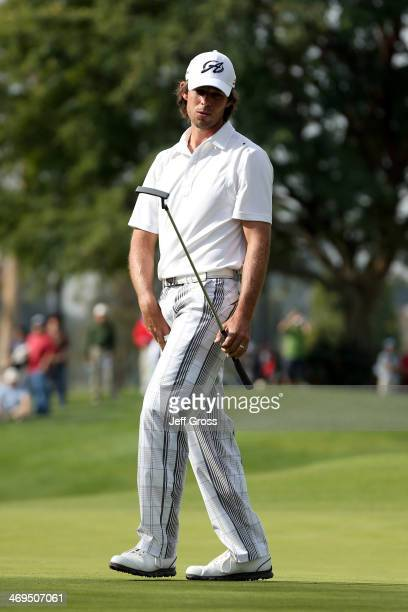 Aaron Baddeley of Australia reacts to a putt on the 1st hole in the third round of the Northern Trust Open at the Riviera Country Club on February 15...