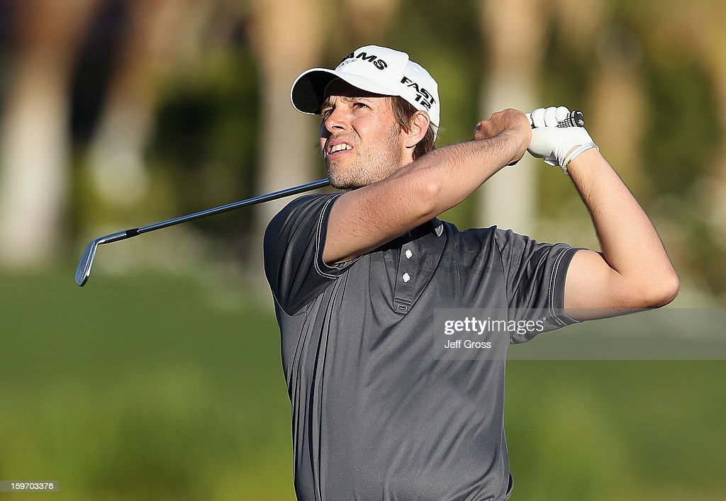 Aaron Baddeley of Australia watches his second shot from the 9th fairway during the second round of the Humana Challenge In Partnership With The Clinton Foundation at La Quinta Country Club on January 18, 2013 in La Quinta, California.