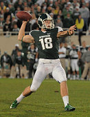 Aaron Bates of the Michigan State Spartans throws a gamewinning touchdown pass on a fake field goal to teammate Charlie Gantt in overtime against the...