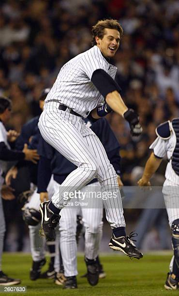 Aaron Boone of the New York Yankees celebrates after hitting the game winning home run in the bottom of the eleventh inning against the Boston Red...